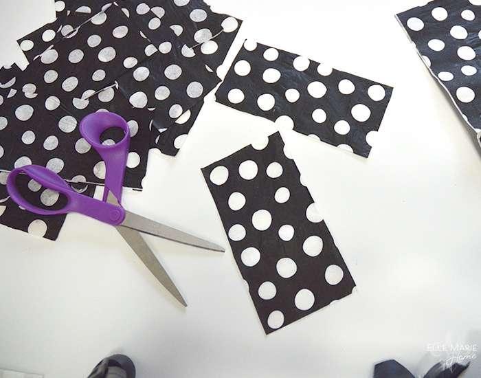 Cutting up polka dot napkins