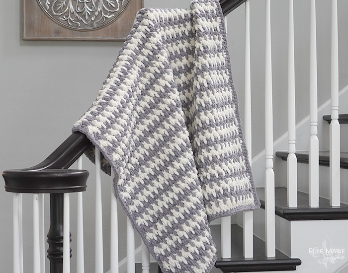 Completed blanket hanging over stair rail
