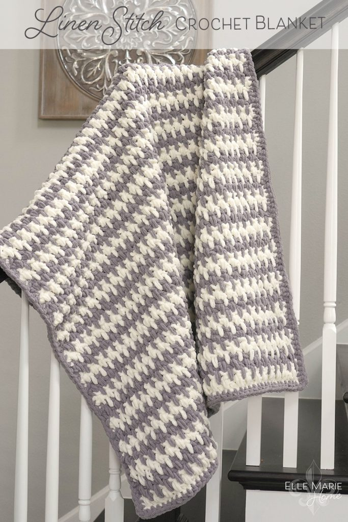 Completed blanket hanging over a stair rail.